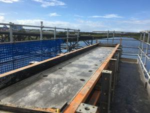 Construction of 3-span Kedron Brook Bridge with a cast insitu concrete substructure, precast deck unit superstructure and cast insitu deck